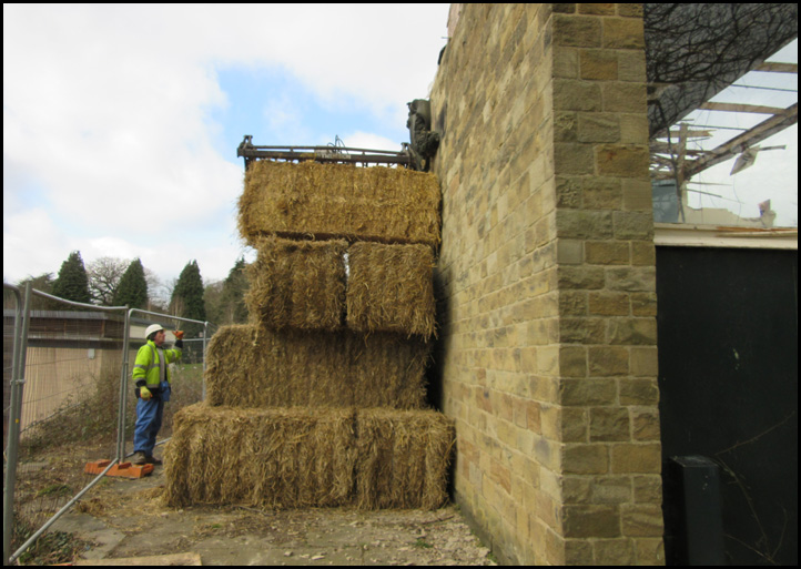 Positioning bales of hay to protect the Tympanum from accidental collapse