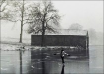 Ela Beaumont - 1930s, with boathouse in the background