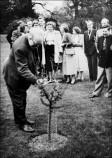 John F. Friend (Foundation Principal) planting a 'Coronation' tree