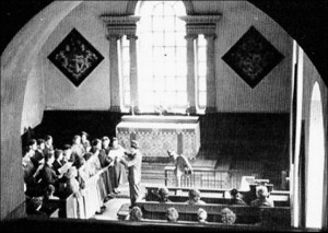 Brian Longthorne conducting a performance of Heinrich Schutz's St Matthew Passion in the Estate Chapel in 1954. (Image from Paul Mann publication.)