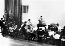 Paul Shepherd conducting a group of musicians in the Music Salon.