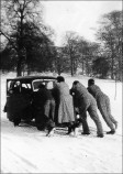 Students rescuing Daphne Bird in her car - 1951
