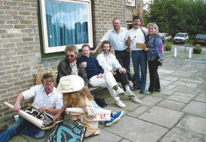 Richard Keyes ( L holding poster) and Margaret Bolderson in cowboy hat. On the bench (L) Pete Tidball,  Dave Farnsworth (former English Language tutor) Alan Swift. Standing Andy Rashleigh, Liam Arthurs and Sue Bachelor.